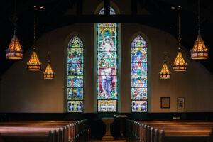 Interior of a church with stained glass windows