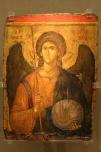 Painted icon of the Archangel Michael, holding a helmet and spear.