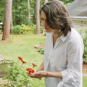 Rhonda Mawhood Lee among the flowers in her back garden.